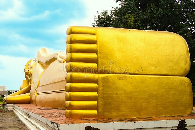 Feet of Reclining Buddha in Buddhist Temple stock images