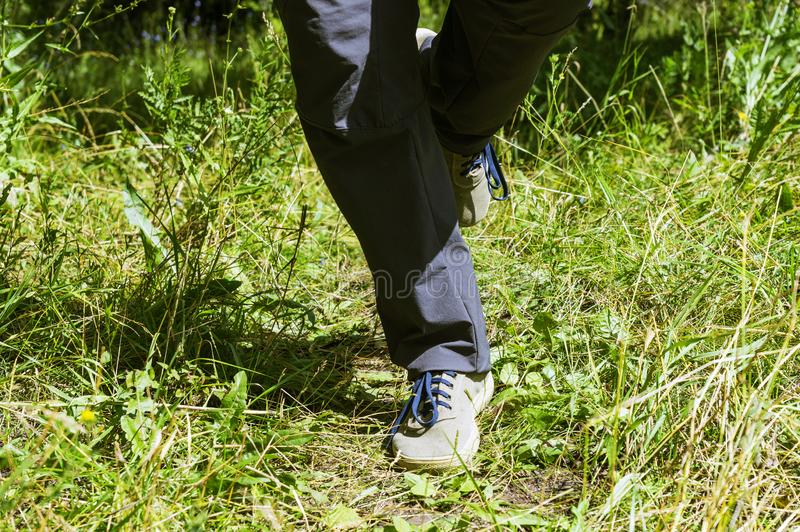 Feet of a man running in nature for background royalty free stock photos