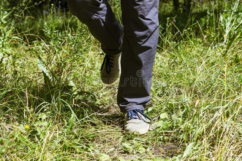 Feet of a man running in nature for background stock images