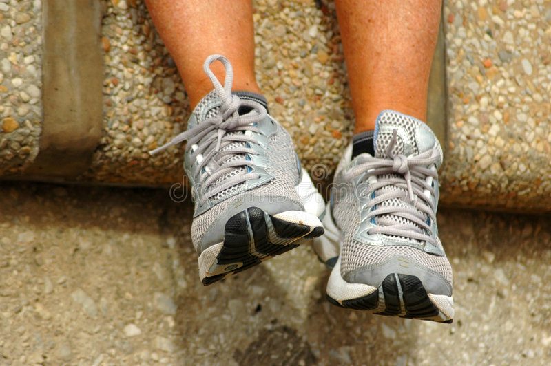 Feet with running shoes stock photography