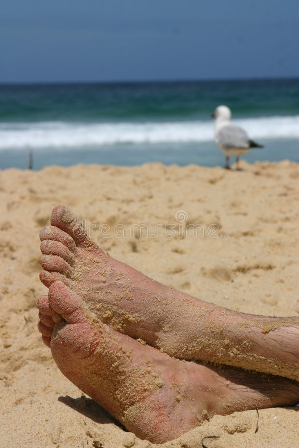Feet on sand royalty free stock photos