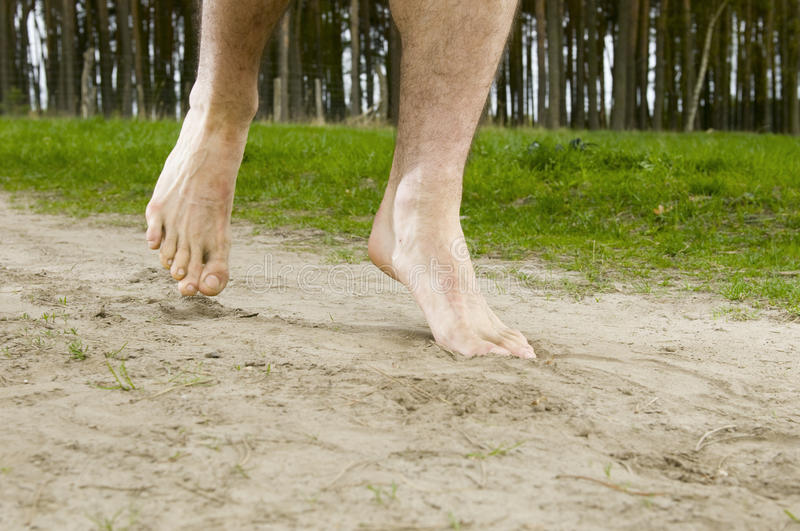 Feet in the sand stock images