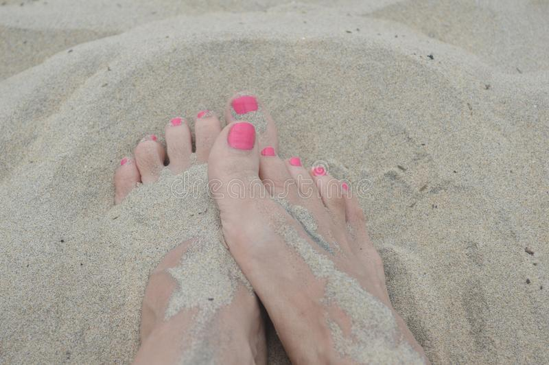 Feet in the sand royalty free stock photo