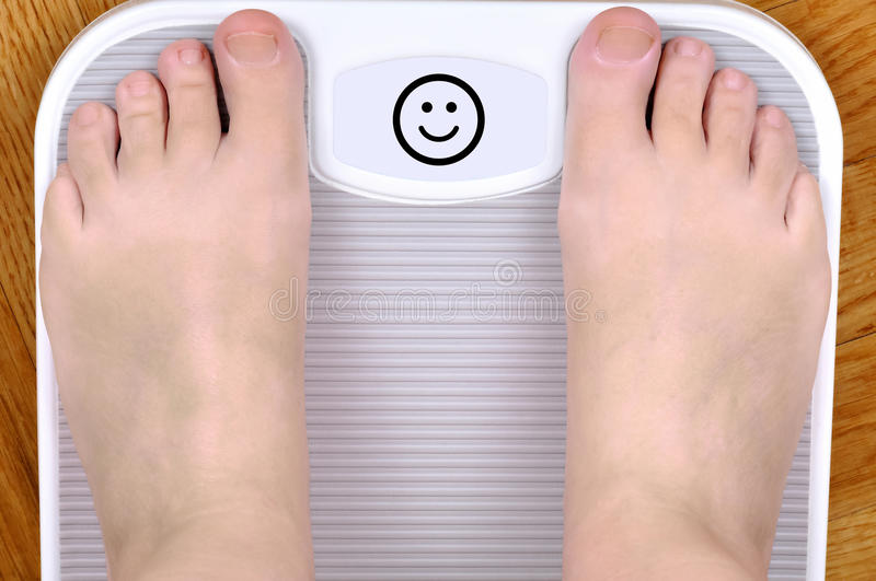 Feet on the scale royalty free stock photography