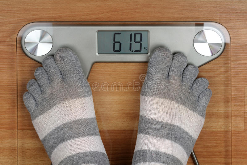 Download Feet on the scales stock photo. Image of heavy, toes - 20394682