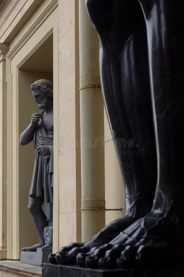 Feet of the Sculptures of Atlantes of the New Hermitage stock image