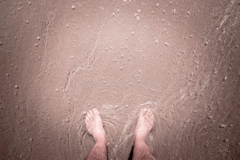 Feet in the sea water stock photos