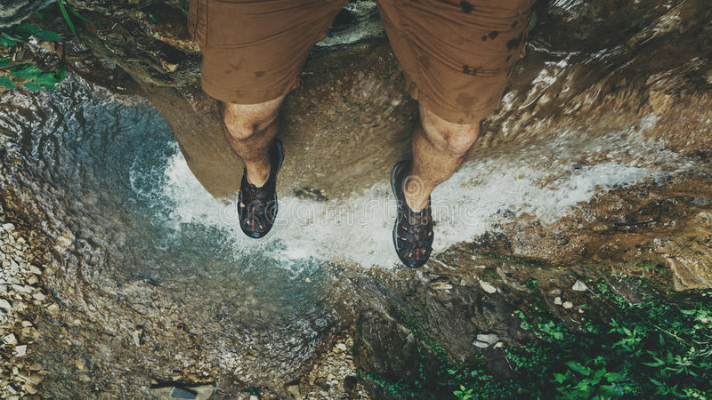 Feet selfie on cliff with waterfall view Travel Lifestyle adventure vacations concept royalty free stock photography