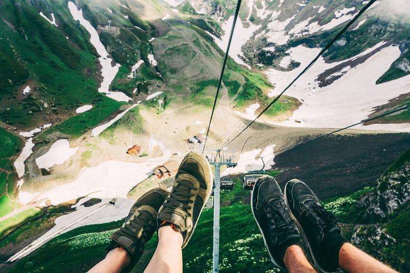Feet Selfie family couple friends hipster shoes Traveler relaxing on cableway Sochi view mountains on background Lifestyle hiking. Feet Selfie family couple royalty free stock photography