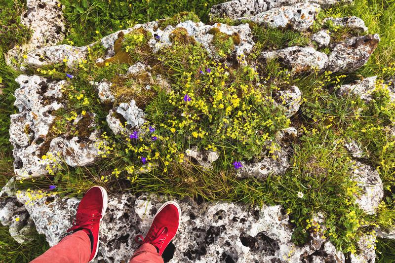 Feet Selfie red sport shoes Traveler standing on stone outdoor nature Lifestyle hiking Travel concept summer vacations. Feet Selfie red sport shoes Traveler stock image