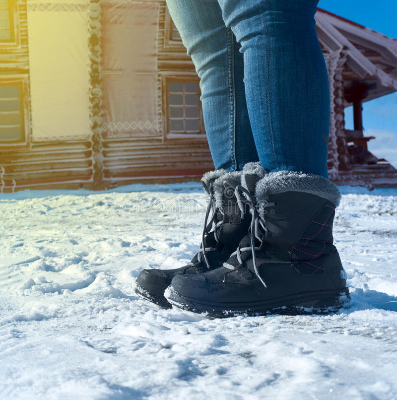 Feet shod in winter shoes.  royalty free stock images