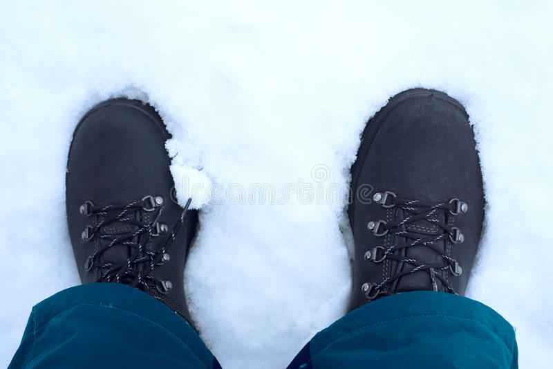 Feet shod in winter shoes.  royalty free stock image