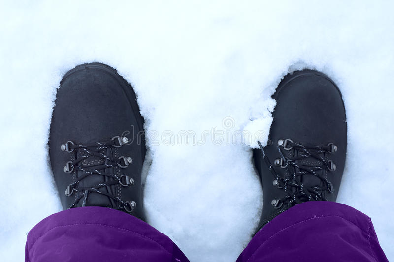 Feet shod in winter shoes.  stock photography