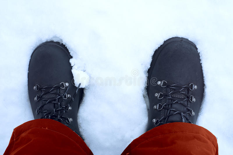 Feet shod in winter shoes.  stock photo