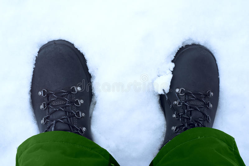 Feet shod in winter shoes.  royalty free stock photo