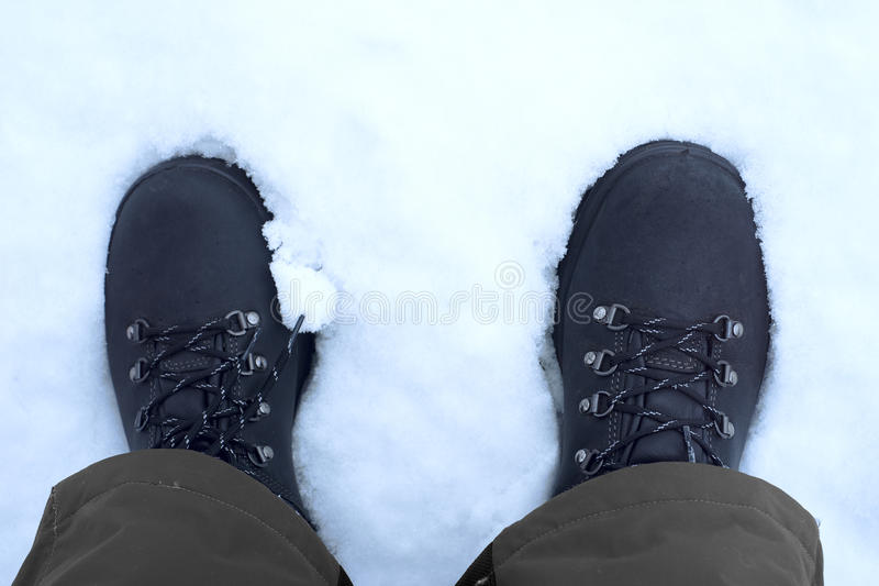Feet shod in winter shoes.  stock photos