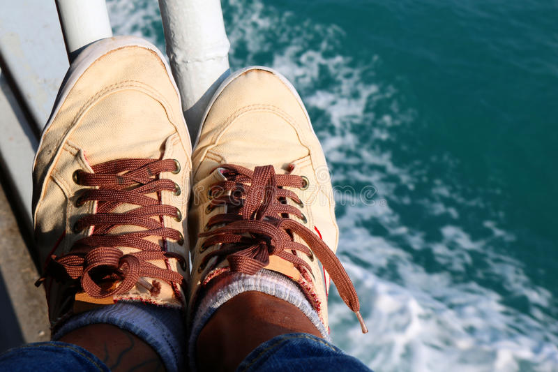 Feet and shoes on the boat. royalty free stock image