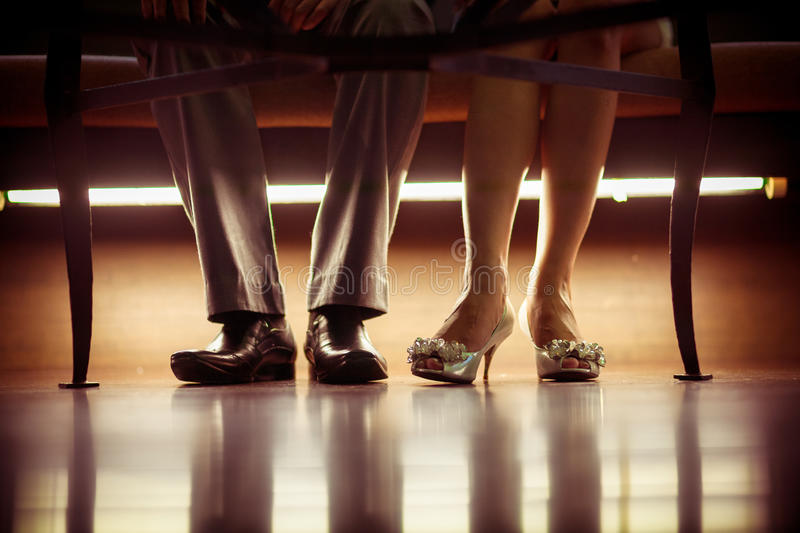 Feet and shoes. Vintage feet and shoes of newlyweds stock photo
