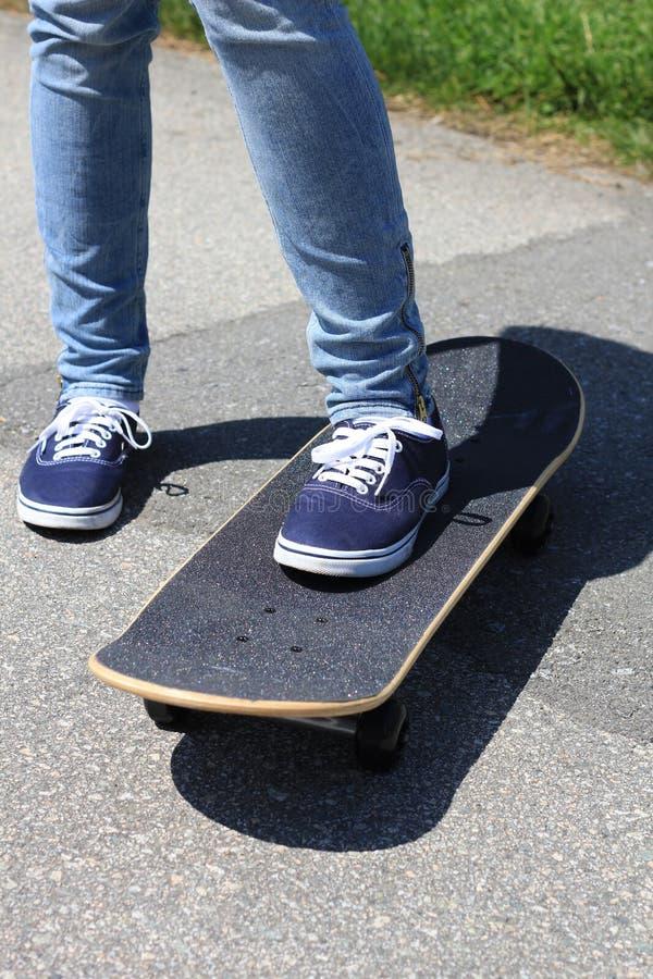 Feet on skateboard stock photos