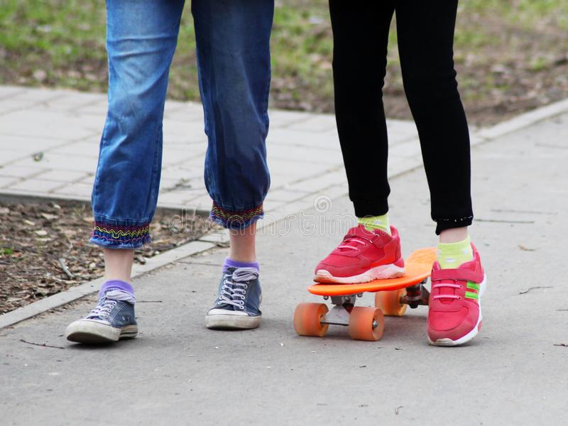 Feet on the skateboard, toned stock photo