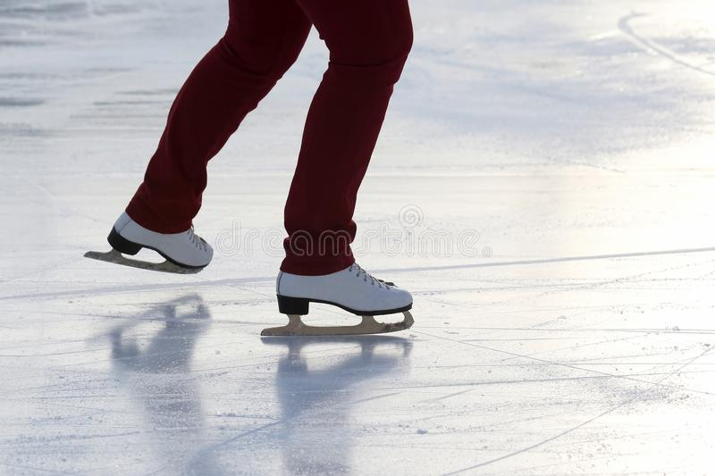 Download Feet On The Skates Of A Person Rolling On The Ice Rink Stock Photo - Image of holiday, cold: 106001636