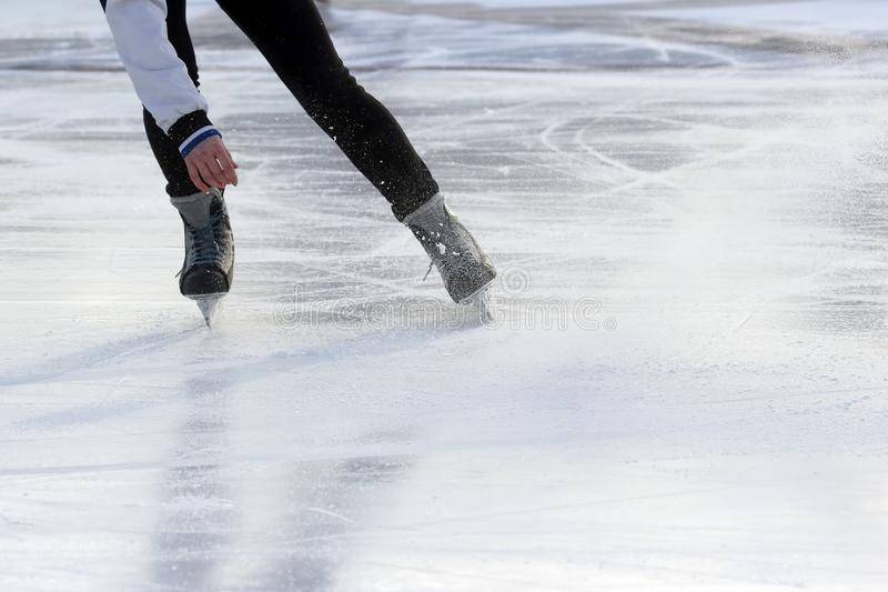 Download Feet On The Skates Of A Person Rolling On The Ice Rink Stock Image - Image of ride, january: 106001713