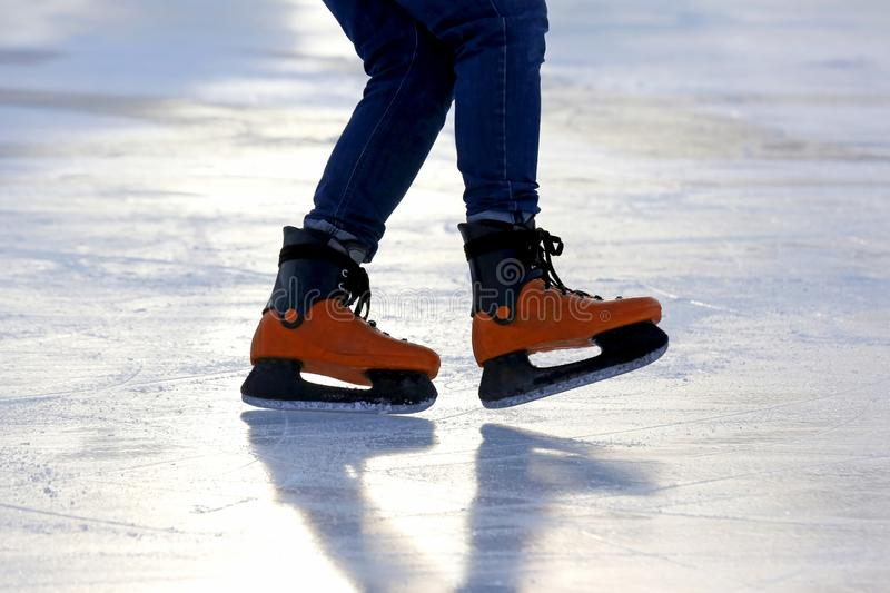 Download Feet On The Skates Of A Person Rolling On The Ice Rink Stock Photo - Image of male, person: 106001846