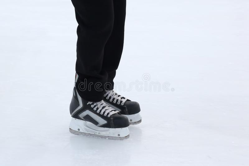 Download Feet On The Skates Of A Person Rolling On The Ice Rink Stock Photo - Image of rolling, activity: 106001930