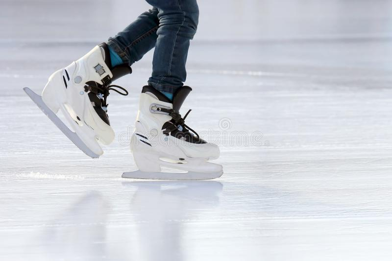 Download Feet On The Skates Of A Person Rolling On The Ice Rink Stock Photo - Image of athlete, skates: 108529178