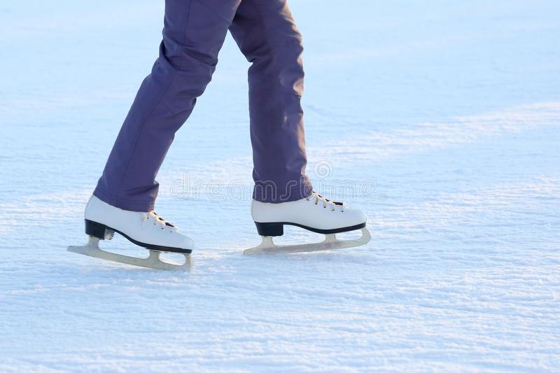 Download Feet On The Skates Of A Person Rolling On The Ice Rink Stock Image - Image of holiday, feet: 108535697