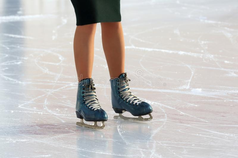 Download Feet On The Skates Of A Person Rolling On The Ice Rink Stock Image - Image of recreation, activity: 110211169