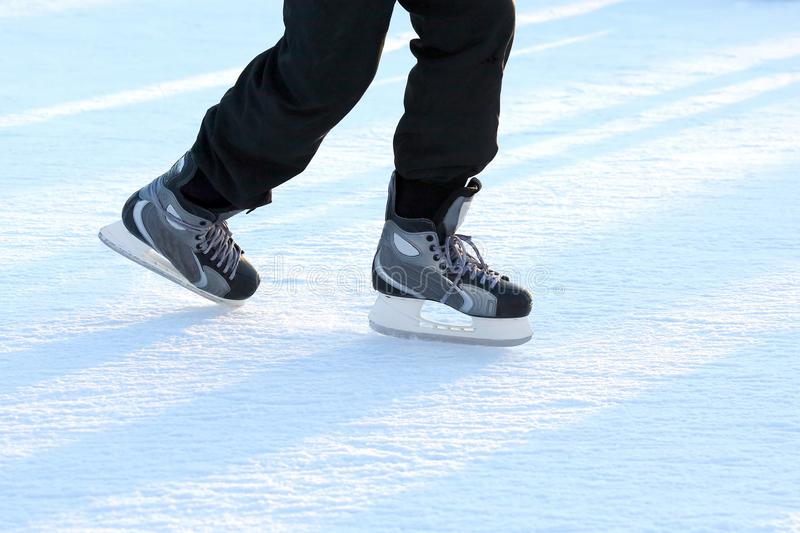 Download Feet On The Skates Of A Person Rolling On The Ice Rink Stock Image - Image of skate, runner: 110211379