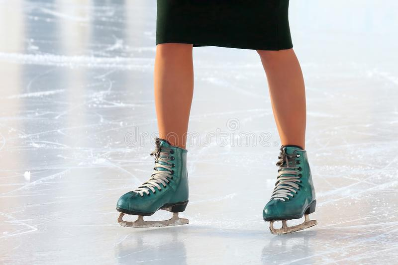 Feet skating girl skating on ice rink.. sports, Hobbies and recreation of active people. Feet skating girl skating on ice rink. sports, Hobbies and recreation of royalty free stock photo