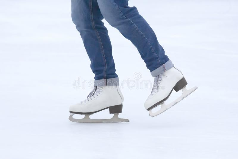 Feet skating on the ice rink. The feet skating on the ice rink royalty free stock photography