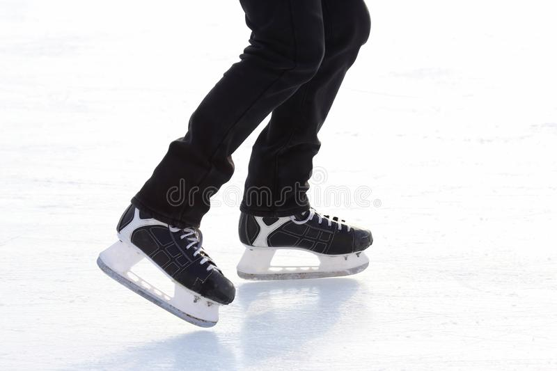 Feet skating on the ice rink. The Feet skating on the ice rink stock image