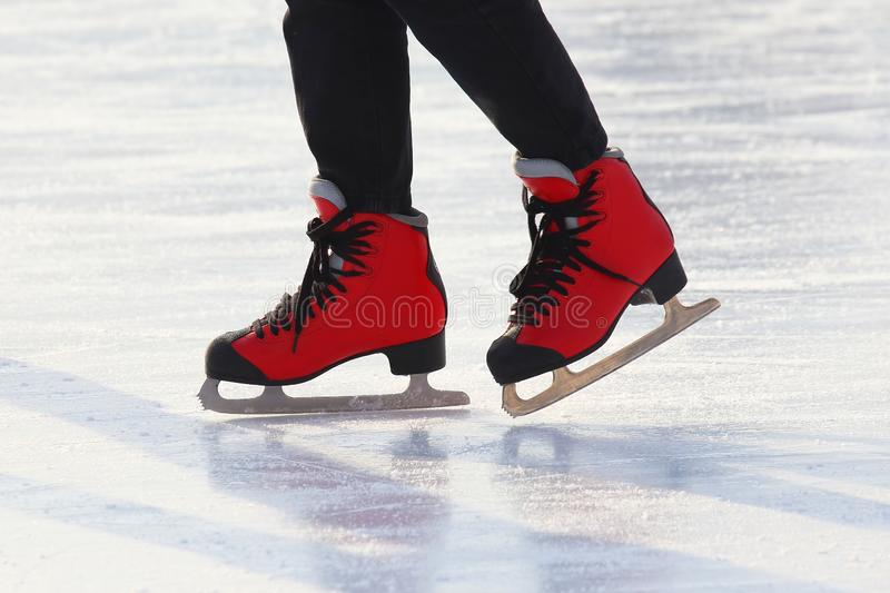 Feet skating on the ice rink. The Feet skating on the ice rink royalty free stock photo
