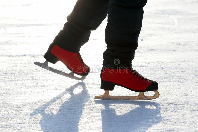 Feet skating on the ice rink. The Feet skating on the ice rink stock photos