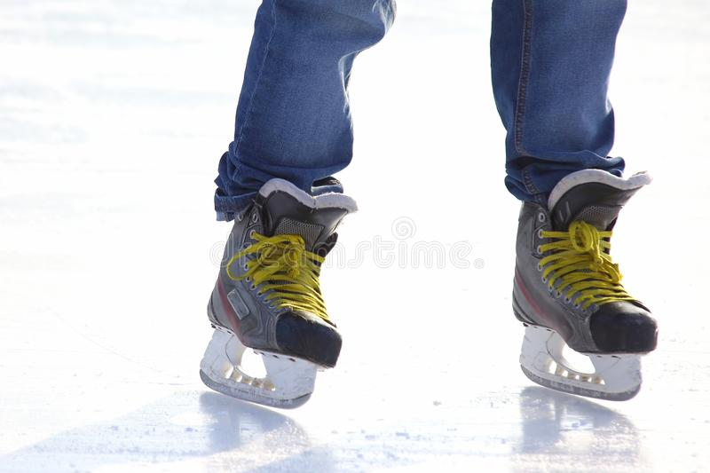Feet skating on the ice rink. The Feet skating on the ice rink stock photo