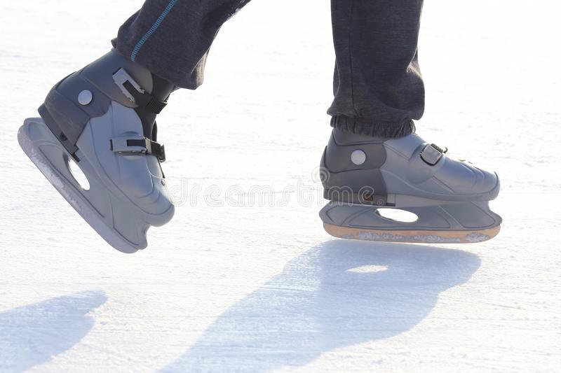 Feet skating on the ice rink. The Feet skating on the ice rink stock photography