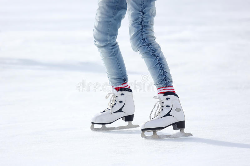 Feet skating on the ice rink. The feet skating on the ice rink stock images