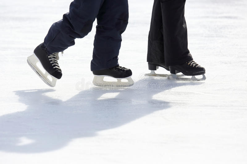 Feet skating on the ice rink. The feet skating on the ice rink royalty free stock photos
