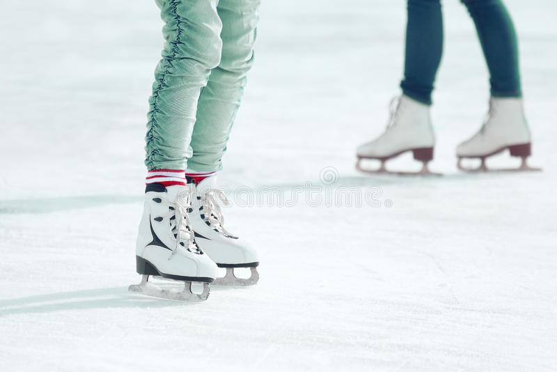 Feet skating on the ice rink. vacation hobbies and sports. The feet skating on the ice rink. vacation hobbies and sports royalty free stock photos