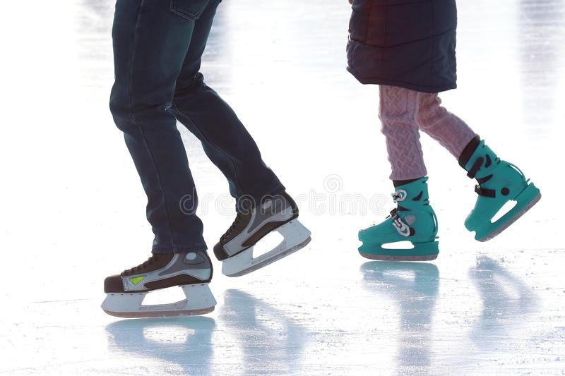 Feet skating on the ice rink. vacation sports and hobbies. The Feet skating on the ice rink. vacation sports and hobbies royalty free stock photos
