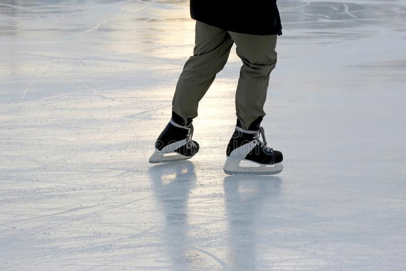 Feet skating person at the rink. The feet skating person at the rink royalty free stock image