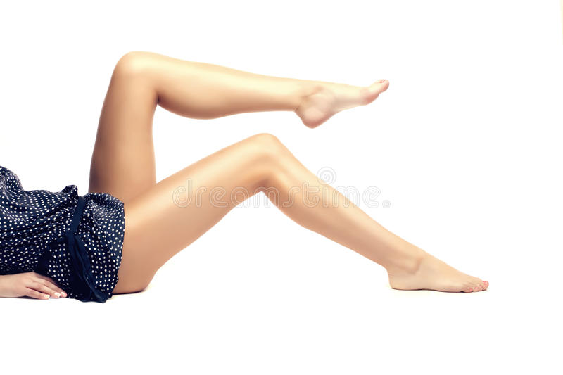 Feet spa, legs foot massage in spa. Woman feet care. Legs stockings, tights royalty free stock photography