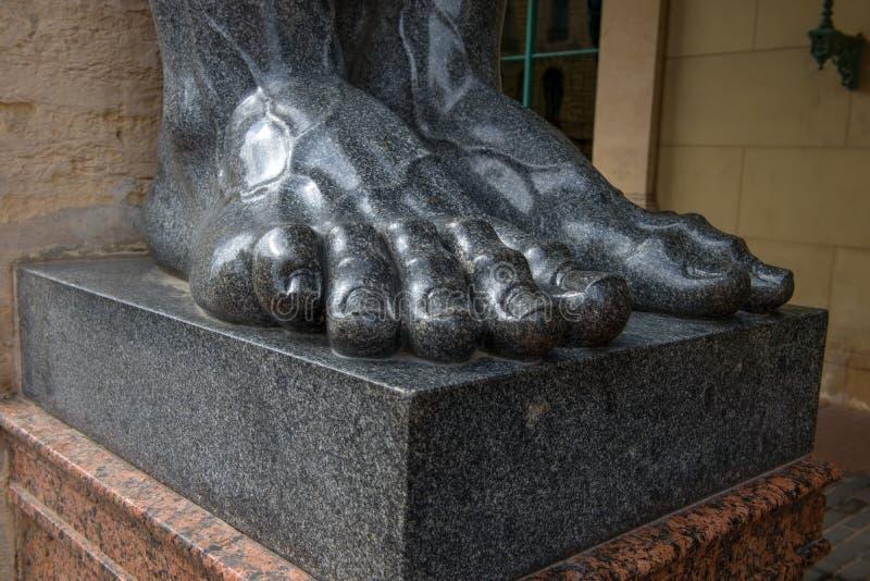 Feet statues of Atlantes royalty free stock photos