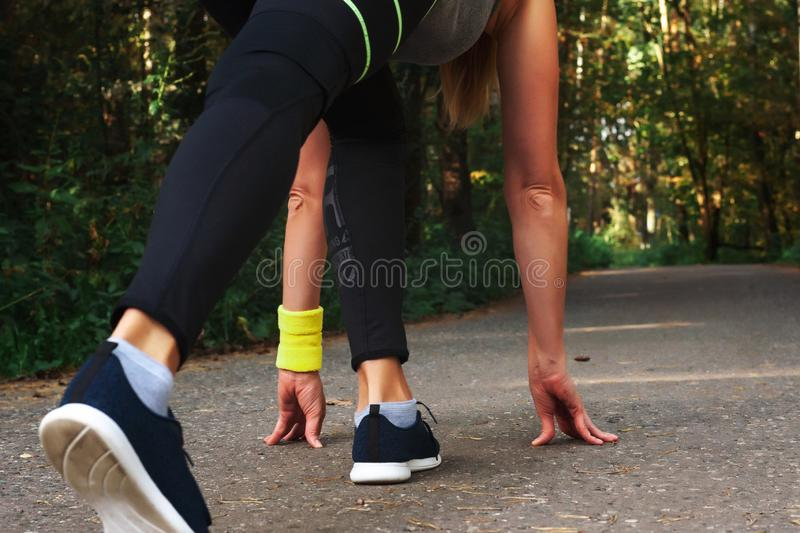 Feet step runner on the road, closeup shoes. Start running on the sidelines. Run outdoor exercise activity concept. Feet step runner on the road, closeup shoes stock image