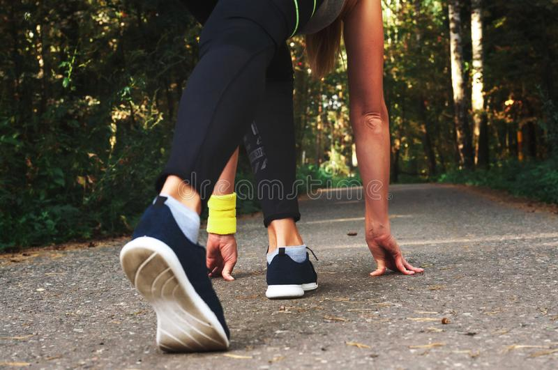 Feet step runner on the road, closeup shoes. Start running on the sidelines. Run outdoor exercise activity concept. Feet step runner on the road, closeup shoes royalty free stock photography