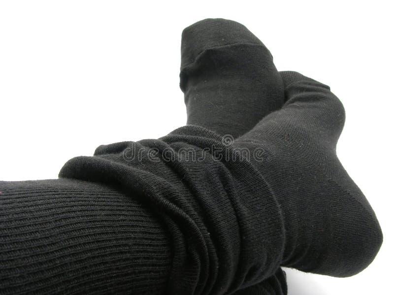 Feet in stockings stock photos