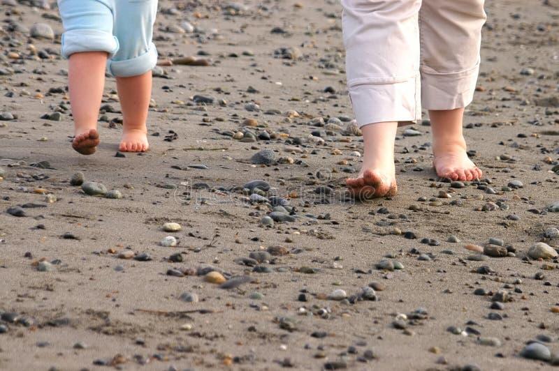 Feet On Stony Beach Stock Image